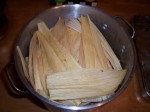 Cover tamales completely with corn husks