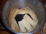 Place tamales on molcajete, open side up. Don't let them touch the water